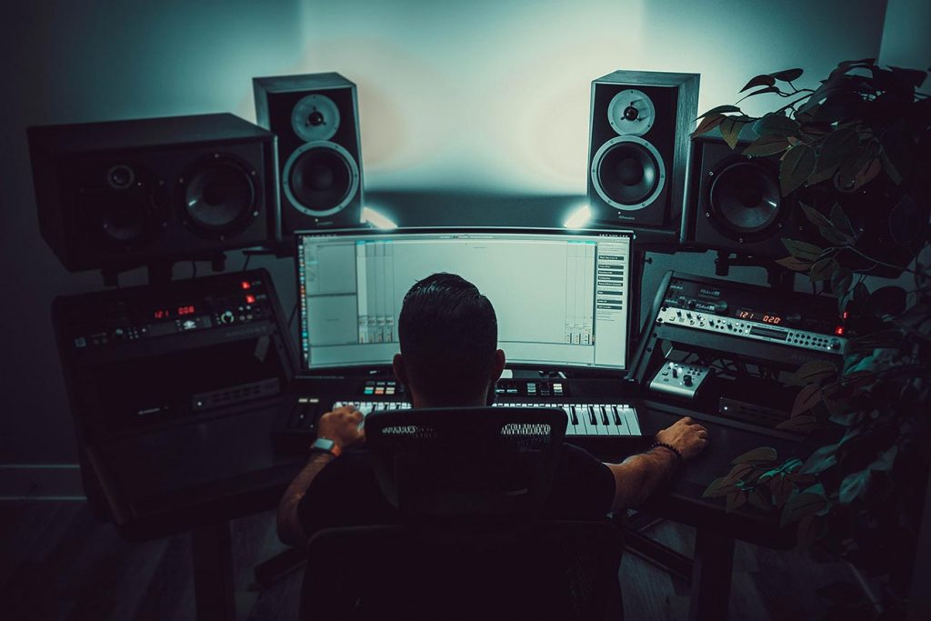 a picture of a man in a music studio using ableton live